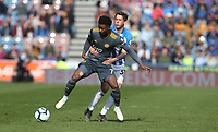 Huddersfield Town's Eric Durm gets to grips with Leicester City's Demarai Gray <br /> <br /> Photographer Stephen White/CameraSport<br /> <br /> The Premier League - Huddersfield Town v Leicester City - Saturday 6th April 2019 - John Smith's Stadium - Huddersfield<br /> <br /> World Copyright © 2019 CameraSport. All rights reserved. 43 Linden Ave. Countesthorpe. Leicester. England. LE8 5PG - Tel: +44 (0) 116 277 4147 - admin@camerasport.com - www.camerasport.com