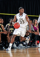 Florida International University guard Tola Akomolafe (33) plays against Alabama State University, which won the game 60-57 on December 3, 2011 at Miami, Florida. .