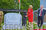 Cllr Michael Courtney looks on as President Mary McAleese unveils the memorial to those who served in the First World War, in Killarney on Thursday.