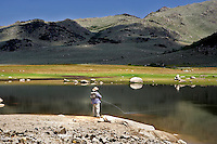 Fly fisherman on Onion Valley Reservoir. Nevada