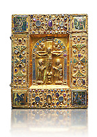 "Medieval gilded manuscript cover depicting the Crucifixion. 11th century from the treasury of the Cathedral of Maastricht. AD.  <br /> This gilded with relief panel with inlaid stones was originally a manuscript cover. Since 1677, it contained the 'documents of the oath of the Dukes of Brabant'. The back of the panel is covered with precious fabrics. On the front, in the central part, is depicted a crucifixion the style of which is reminiscent of the works of the goldsmiths of the Emperor Henry II. On the borders are small icons and emblems including those of the Carolingians. The main interest of this work lies in the four enamelled on gold symbols of the evangelists in the four corners, two being 'Enforced' on a background of gold, the others being painted.<br /> <br /> One of Latin inscriptions states that 'Beatrice  ordered the execution ( of this work) in honour of Almighty God and his saints"". It could be Beatrice wife of Hermann II of Swabia and daughter Emperor's sister-Conrad II or, more likely, Beatrice of Tuscany who in 1036 was wife of Boniface III, Marquis of Tuscany, and second wife of Geoffrey the Bearded, Duke of Lower Lorraine and Brabant.<br />  The Louvre Museum, Paris."