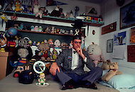 Hollywood, Los Angeles, California. November 1982. The artist-inventor Philip Garner devises the most incredible and stunning objects. Philip in his room surrounded with his teddy bears and pet toys which remind him that his childhood is not too far away.