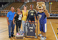 Florida International University women's volleyball player Renele Forde (14) was honored on senior night after the game against Florida Gulf Coast University.  FIU won the match 3-0 on November 8, 2011 at Miami, Florida. .