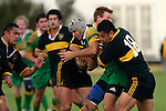 Drury centre C. Anderson.  is wrapped up by G. Pyne & E. Kipisi.  Counties Manukau Premier Club Rugby, Drury vs Bombay played at the Drury Domain, on the 14th of April 2006. Bombay won 34 - 13.