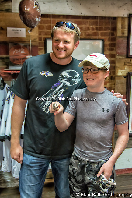 Super Bowl Champions Baltimore Ravens player Morgan Cox signs autographs at the Collierville Dixie Pickers. <br />