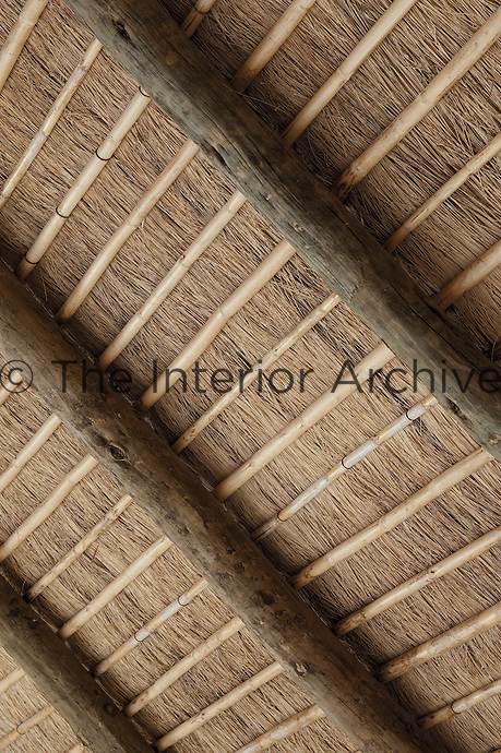The contemporary thatched roof at CasasNaAreia is held together inside with lengths of bamboo