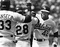 Dave Henderson A's centerfielder congratulated at after HR. (1988 photo by Ron Riesterer)