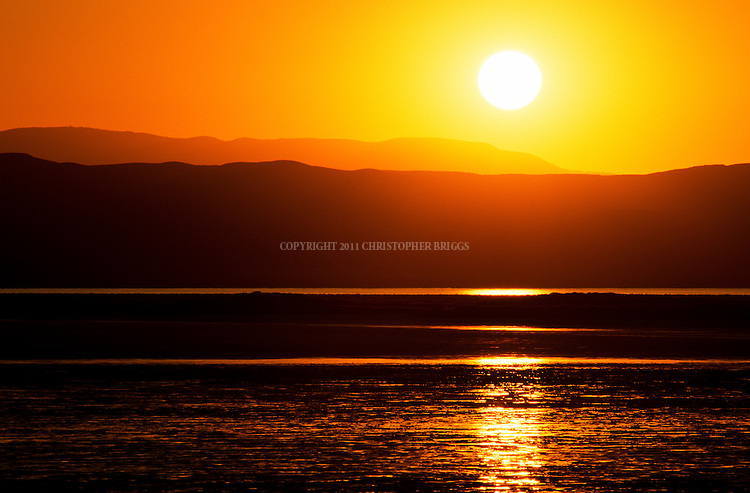 Sunset reflections on Soda Lake, a 3,000 acre seasonal alkali lake in the Carrizo Plain; roughly 50 miles (80 km) long and up to 15 miles (24 km) across. Contains the 250,000 acre (1,012 km²; 101,215 ha) Carrizo Plain National Monument (Est. 1/17/2001), largest single native grassland (San Joaquin Valley biogeographic province) remaining in California. San Luis Obispo County, CA.