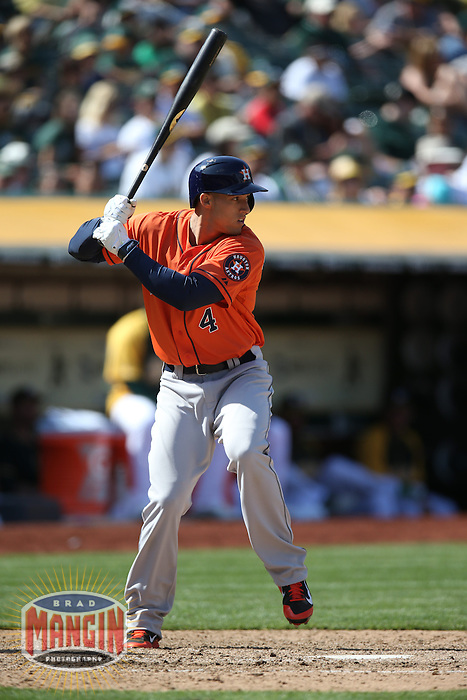 OAKLAND, CA - APRIL 19:  George Springer #4 of the Houston Astros bats against the Oakland Athletics during the game at O.co Coliseum on Saturday, April 19, 2014 in Oakland, California. Photo by Brad Mangin