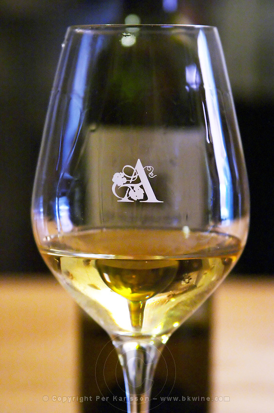 Glass embossed with A. Domaine d'Aupilhac. Montpeyroux. Languedoc. France. Europe. Bottle.