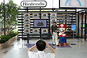 June 29, 2010 - Tokyo, Japan - A visitor of Panasonic Center Tokyo poses with mascot Nintendo's popular game character Super-Mario on June 29, 2010.