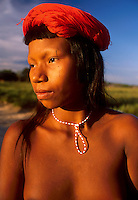 Portrait of a young woman wearing adornments, Krahô indigenous people, Tocantins State, Brazil.