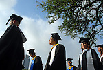 Members of the graduating class of 2009 make their way to their seats at the commencement ceremony at Rice University Saturday mornging May 09,2009.(Dave Rossman/For the Chronicle)