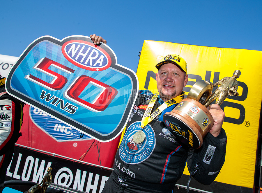 Jul 28, 2019; Sonoma, CA, USA; NHRA funny car driver Robert Hight celebrates after winning the Sonoma Nationals for the 50th victory of his career at Sonoma Raceway. Mandatory Credit: Mark J. Rebilas-USA TODAY Sports