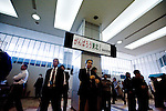 """People await the arrival of friends and colleagues under a sign reading """"Fight Sendai!"""" at the arrivals terminal  of Sendai airport in Natori, Miyagi Prefecture, Japan on 14 April, 2011. .Photographer: Robert Gilhooly"""