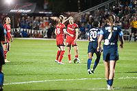 Kansas City, Mo. - Saturday April 23, 2016: Portland Thorns FC midfielder Tobin Heath (17) and defender Emily Sonnett (16) strategize before a free kick against FC Kansas City at Swope Soccer Village. The match ended in a 1-1 draw.