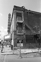 Montreal (qc) CANADA - file Photo - 1990 - <br /> <br /> <br /> -<br /> <br /> The Seville Theatre was a movie theatre on Sainte-Catherine street West between rues Lambert-Closse and Chomedey in Montreal, Canada, in a district now known as Shaughnessy Village. After closing in 1985 the theatre was shuttered and remained abandoned for 25 years. It was demolished October 2010.<br /> <br /> The theatre, designed by Cajetan L. Dufort, was built in 1929 (just five years after the nearby Montreal Forum) in a then-bustling part of downtown Montreal. Its interior was designed by Emmanuel Briffa.[1]<br /> <br /> The Seville was a single-screen, 1148 seat theatre and one of only 15 atmospheric theatres ever built in Canada.[2] Its interior had a Spanish theme (hence the name 'Seville') with its ceiling painted to resemble a night sky with sparkling stars. There was an additional mechanism in place that could be turned on to give the appearance of clouds moving across the sky.The theatre was built with shops in the front, including an ice cream parlour on the east side and a drugstore on the west [3]<br /> <br /> In the 1940s the theatre became a live theatre, hosting a variety of performers including Nat King Cole, Tony Bennett, Peggy Lee, Sammy Davis Jr., Frank Sinatra and Louis Armstrong.