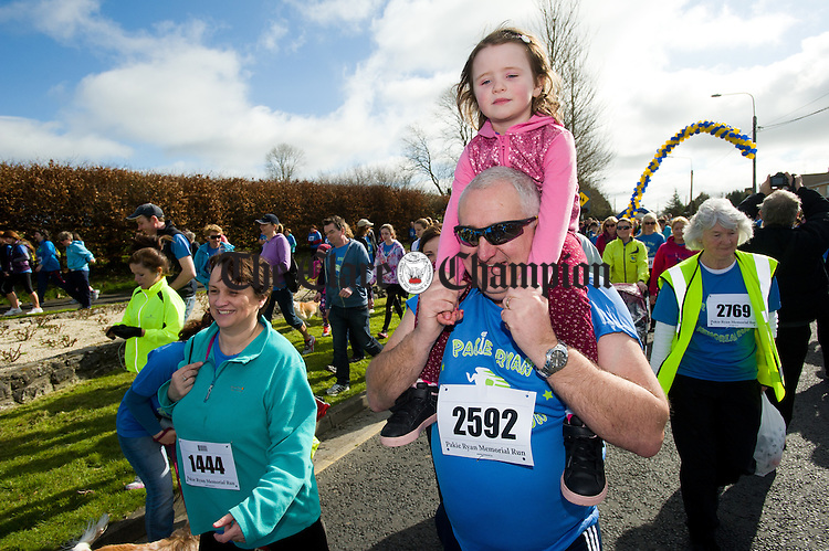 Roger Fox of Ennis gives a lift to little Ella White at the Pakie Ryan Memorial Run in Newmarket on Fergus. Photograph by John Kelly.