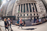 Tourists and workers enjoy an unseasonably mild winter's day the front of the New York Stock Exchange on Friday, February 24, 2017. In advance of the Snap Inc. initial public offering the NYSE plans to conduct a practice run to stress test their system to ensure that nothing will go wrong on the first day of trading next week. The Snap Inc. ipo is expected to be the largest initial public offering in almost five years. (© Richard B. Levine)