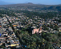 aerial photograph of the San Bernadino Church in the center of Xochimilco, greater Mexico City; the Guadalupe Mountains are visible in the background, left.