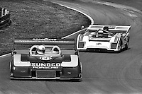 LEXINGTON, OH - AUGUST 11: Brian Redman drives Roger Penske's Porsche 917/30 003 ahead of Monte Shelton in his McLaren M8F 1/Chevrolet during the Buckeye Cup SCCA Can-Am race at the Mid-Ohio Sports Car Course near Lexington, Ohio, on August 11, 1974.