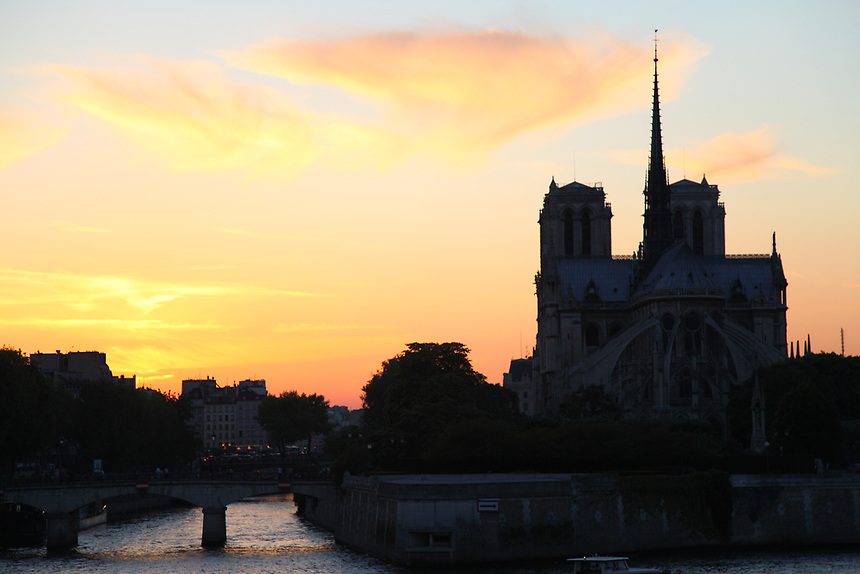 Paris Left Bank: The back of Notre Dame within its isle, in the light of an artistic sunset.