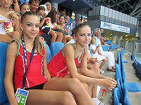 (L-R) Ksenya Cheldishkina and Maria Kadobina (junior) of Belarus portrait made from fan seats at 2010 Pesaro World Cup on August 27, 2010 at Pesaro, Italy.  Photo by Tom Theobald.