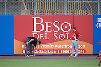 Palm Beach Cardinals right fielder Nick Thompson (27) watches as umpire Matt Snodgrass checks a ball that got stuck under the outfield wall during a game against the Dunedin Blue Jays on April 15, 2016 at Florida Auto Exchange Stadium in Dunedin, Florida.  Dunedin defeated Palm Beach 8-7.  (Mike Janes/Four Seam Images)