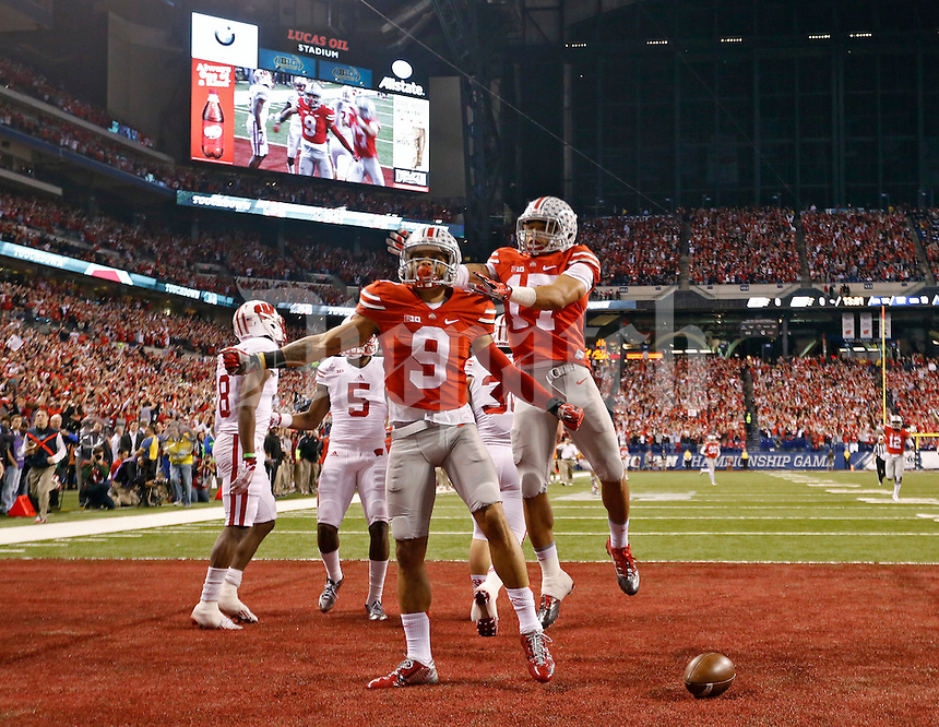 Ohio State Buckeyes wide receiver Devin Smith (9) celebrates his touchdown catch with Ohio State Buckeyes running back Jalin Marshall (17) during the 1st quarter in the 2014 Big Ten Football Championship Game at Lucas Oil Stadium in Indianapolis, Ind. on December 6, 2014.  (Dispatch photo by Kyle Robertson)