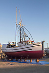 Port Townsend, Boat Haven, classic, wooden, fishing boat, Bernice, rigged for bottom fish, on the hard for repairs, Port of Port Townsend, Jefferson County, Olympic Peninsula, Puget Sound, Washington State, Pacific Northwest, USA,