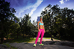 Young Blonde fit Athletic woman exercising in Central Park