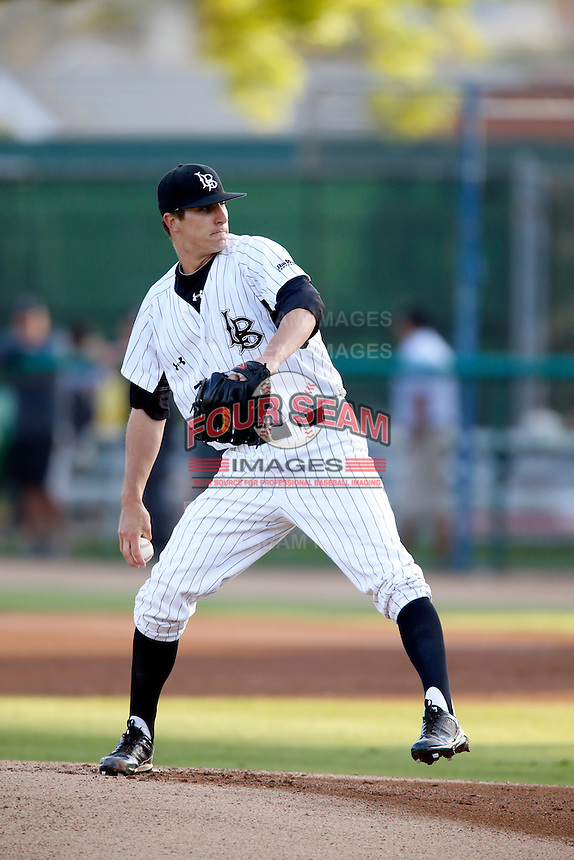 Shane Carle #22 of the Long Beach State 49'ers pitches against the Cal State Fullerton Titans at Blair Field on March 22, 2013 in Long Beach, California. (Larry Goren/Four Seam Images)
