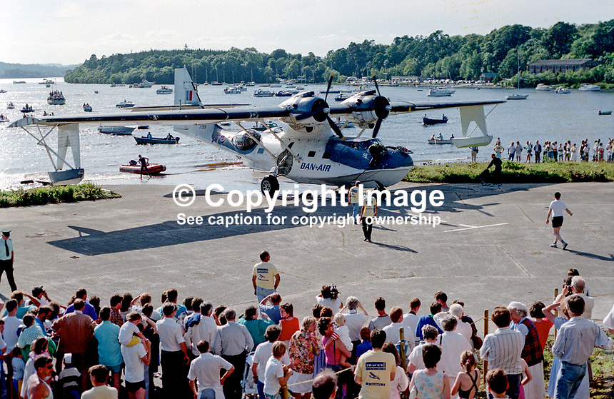 The Catalina Flying Boat, which landed on Lough Erne trundles ashore near the Lough Erne Yacht Club, Killadeas, Co Fermanagh, N Ireland, on 25 May 1991 fifty years to the day after another Catalina flying from nearby Castle Archdale took off to and during the very long flight on 26 May sighted the German battleship, Bismarck, enabling Allied Forces to track and sink it on 27 May. 199105250026..Copyright Image from Victor Patterson, 54 Dorchester Park, Belfast, UK, BT9 6RJ..Tel: +44 28 9066 1296.Mob: +44 7802 353836.Voicemail +44 20 8816 7153.Skype: victorpattersonbelfast.Email: victorpatterson@mac.com.Email: victorpatterson@ireland.com (back-up)..IMPORTANT: If you wish to use this image or any other of my images please go to www.victorpatterson.com and click on the Terms & Conditions. Then contact me by email or phone with the reference number(s) of the image(s) concerned.