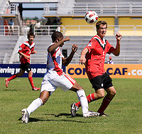 Daniel Stanese (5) of Canada heads the ball away from Jomal Williams (10) of Trinidad & Tobago during the quarterfinals of the CONCACAF Men's Under 17 Championship at Catherine Hall Stadium in Montego Bay, Jamaica. Canada defeated Trinidad & Tobago, 2-0.