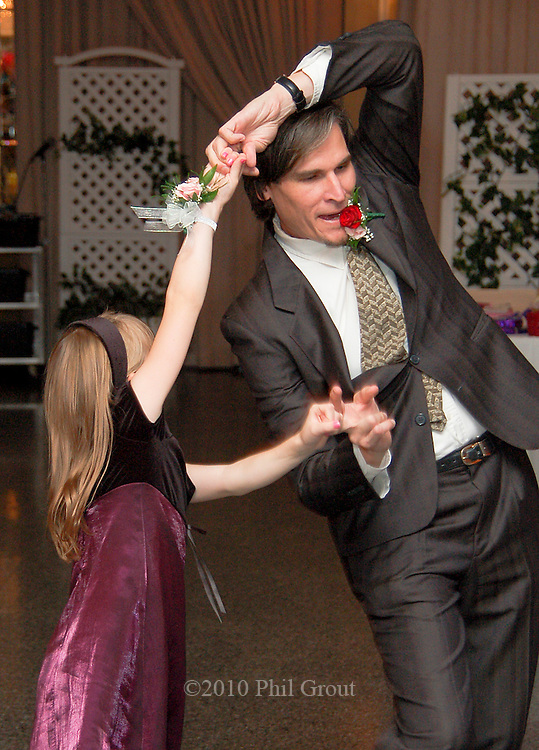 Photo by Phil Grout..And then Jessee gives her Dad a twirl and it looks as if Craig is.clinching his boutonniere in his teeth like some Flamenco dancer..