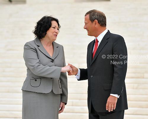 Washington, DC - September 8, 2009 -- Associate Supreme Court Justice Sonia Sotomayor  and Chief Justice of the United States John G. Roberts, Jr. shake hands as they pose for photos during a photo-op following the investiture ceremony in honor of Justice Sotomayor at the United States Supreme Court in Washington, D.C. on Tuesday, September 8, 2009..Credit: Ron Sachs / CNP