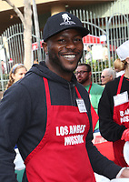 21 December 2018 - Los Angeles, California - Edwin Hodge. Los Angeles Mission Christmas Meal for the Homeless held at Los Angeles Mission. Photo Credit: F. Sadou/AdMedia