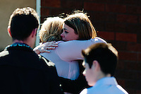 Tuesday 11 March 2014<br /> Pictured: Distressed mum Sharon John (in pink) is comforted by friends as she leaves after the service<br /> Re: A funeral has taken place  in Pontyberem Catholic Church for six day old Eliza-Mae Mullane who died after an incident at the family home in Carmarthenshire in the morning of 18 February 2014, where police later seized two dogs, an Alaskan Malamute called Nisha and a collie cross that were destroyed following the baby girl's death.<br /> Parents Sharon John and Patrick Mullane said previously that they would cherish the short time they had with her.