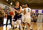 SIOUX FALLS, SD - DECEMBER 31: Drew Guebert #23 from the University of Sioux Falls passes the ball out of a double team from Augustana University including John Warren #3 during their game Sunday afternoon December 31, 2017 at the Stewart Center in Sioux Falls, SD.  (Photo by Dave Eggen/Inertia)