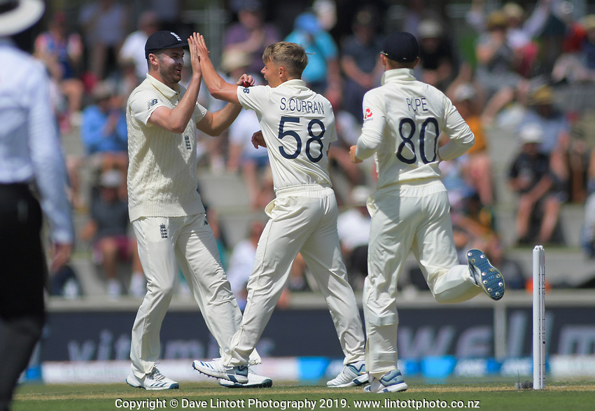 England's Sam Curran celebrates taking the wicket of NZ's Tom Latham during day two of the international cricket 1st test match between NZ Black Caps and England at Bay Oval in Mount Maunganui, New Zealand on Friday, 22 November 2019. Photo: Dave Lintott / lintottphoto.co.nz