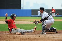Staten Island Yankees catcher Trent Garrison (24) tags out State College Spikes base runner Carson Kelly (27) during game played at Richmond County Bank Ballpark at St.George on August 8, 2013 in Staten Island, NY.  Staten Island defeated State College 6-5.  (Tomasso DeRosa/Four Seam Images)