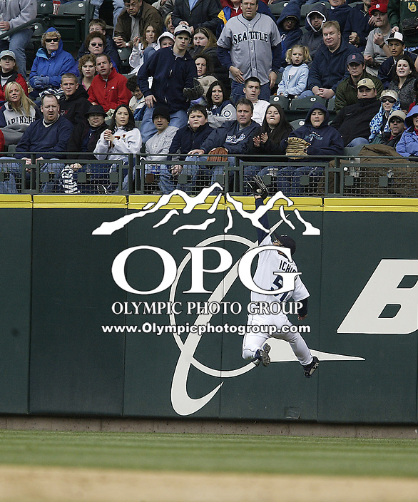Seattle Mariners Right Fielder Ichiro Suzuki leaped in the air to make a over the should catch to end the inning against the Texas Rangers at Safeco field in Seattle, Wa.
