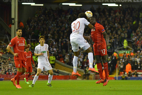 25.02.2016. Liverpool, England. UEFA Europa League game between Liverpool FC and Augsburg.  CAIUBY (FC Augsburg) challenges for the header with Joe Gomez (FC Liverpool)