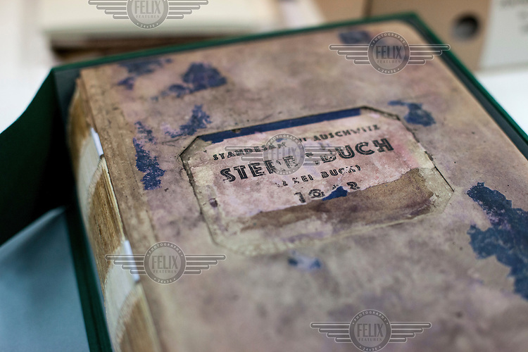 A death register (Sterbebuch) in the Auschwitz  Museum's preservation laboratory for documents, books and other historical papers. 51 death registers have been preserved. It takes three to four staff approximately three months work to preserve each volume. It is estimated that between 1.1 and 1.5 million Jews, Poles, Roma and others were killed in Auschwitz-Birkenau during the Holocaust between 1940-1945. 27 January 2015 is the 70th anniversary of the liberation of Auschwitz-Birkenau.