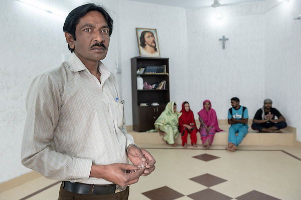 17. Pastor Pervez at the newly renovated Joseph Colony Catholic Church.<br />