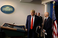 United States President Donald J. Trump arrives at a press briefing on the Coronavirus COVID-19 pandemic with members of the Coronavirus Task Force at the White House in Washington on March 19, 2020. Looking on from right is Stephen Hahn, Commissioner, US Food and Drug Administration (FDA).<br /> Credit: Yuri Gripas / Pool via CNP/AdMedia
