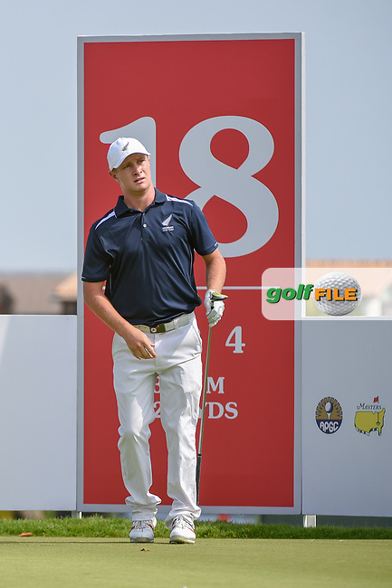 Charlie HILLIER (NZL) watches his tee shot on 18 during Rd 1 of the Asia-Pacific Amateur Championship, Sentosa Golf Club, Singapore. 10/4/2018.<br /> Picture: Golffile | Ken Murray<br /> <br /> <br /> All photo usage must carry mandatory copyright credit (© Golffile | Ken Murray)