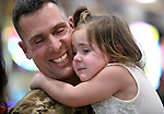 Chief Warrant Officer III Ian Dasmann gets a hug from his daughter Emma, 3, as he and fellow Nevada Army Guard soldiers arrive at the Reno-Tahoe International Airport in Reno, Nev., on Sunday, Feb. 16, 2014. About 300 supporters greeted the 1/168th General Support Battalion after a 10-month deployment in Afghanistan. (Las Vegas Review-Journal/Cathleen Allison)