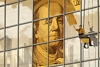 Window cleaner unveiling one hundred-dollar bill ExclusiveImage