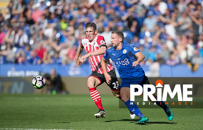 Danny Drinkwater of Leicester City moves away from Pierre-Emile Hojbjerg of Southampton during the Premier League match between Leicester City and Southampton at the King Power Stadium, Leicester, England on 2 October 2016. Photo by Andy Rowland.
